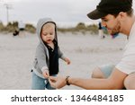 adorably perfect young father... | Shutterstock . vector #1346484185