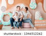 happy family sitting on a large ... | Shutterstock . vector #1346512262