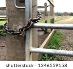 Padlocked Gate With Path Into...
