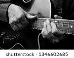 Guitarist Hands And Guitar...