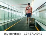 young man pulling suitcase in... | Shutterstock . vector #1346714042