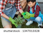 family and kid water spray a... | Shutterstock . vector #1347013328