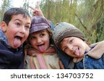 happy laughing elementary... | Shutterstock . vector #134703752