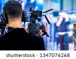 video operator shoots on camera.... | Shutterstock . vector #1347076268
