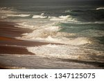 White Waves Breaking Onto...