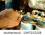 Small photo of Hands Holding a Wrench and Tighten very Rusty Bolts.