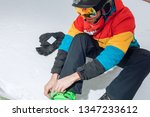 young sporty man tightening the ... | Shutterstock . vector #1347233612