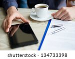 businessman using a tablet and... | Shutterstock . vector #134733398