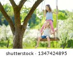 two cute sisters having fun on... | Shutterstock . vector #1347424895