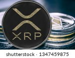 Coin cryptocurrency ripple on the background of a stack of coins. xrp