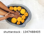 foot bath in stone basin with... | Shutterstock . vector #1347488405