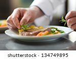 chef decorating a dish in... | Shutterstock . vector #134749895