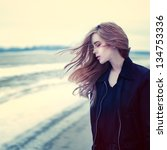 beautiful girl in windy...   Shutterstock . vector #134753336