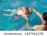 baby with mom learns to swim in ... | Shutterstock . vector #1347561278