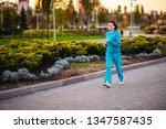 an elderly woman goes in for... | Shutterstock . vector #1347587435