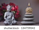 Stones Tower And Candle  Buddha
