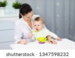 a young mother teaches her... | Shutterstock . vector #1347598232