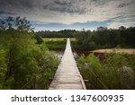 suspended wooden bridge on the...   Shutterstock . vector #1347600935