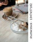 Small photo of Sugar tongs and bowl