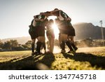 Rugby Team Standing In A Huddl...