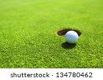 golf ball on lip of cup | Shutterstock . vector #134780462