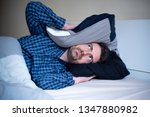 man angry because noise at... | Shutterstock . vector #1347880982