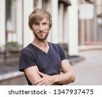 handsome smiling young man... | Shutterstock . vector #1347937475