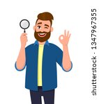 smart young man holding... | Shutterstock .eps vector #1347967355