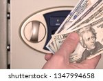 Male Hand With Us Dollars On...