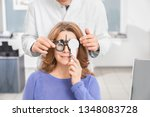 doctor ophthalmologist... | Shutterstock . vector #1348083728