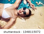 sensual young woman taing a... | Shutterstock . vector #1348115072