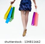 girl in blue dress with packages