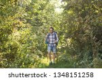 Stock photo adventures summer tourism and nature concept tourist arriving to a camping with his cat 1348151258