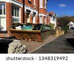 full industrial rubbish skip in ... | Shutterstock . vector #1348319492
