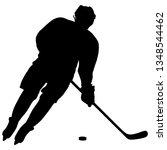 silhouette of hockey player.... | Shutterstock .eps vector #1348544462