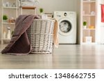 Stock photo basket with laundry in room 1348662755