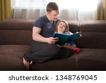 father reading a story to his... | Shutterstock . vector #1348769045