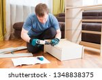 man putting together self... | Shutterstock . vector #1348838375