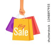 hand holding paper sale bags... | Shutterstock .eps vector #1348897955