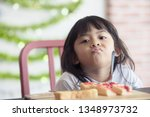 cute baby eating boring food... | Shutterstock . vector #1348973732