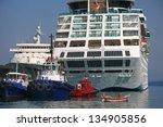 Kusadasi port - small and big boat - stock photo