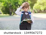 boy hold his head from school... | Shutterstock . vector #1349067272