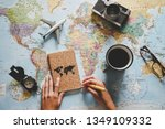 Small photo of Top view of young woman planning her vacation using world map - Travel influencer looking for the next travel destination - Concept of adventure, tourism, and traveling people lifestyle