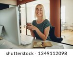young businesswoman smiling... | Shutterstock . vector #1349112098
