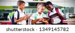 Stock photo smiling school kids using digital tablet in cafeteria at school 1349145782