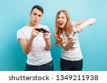 excited young couple  a guy and ... | Shutterstock . vector #1349211938