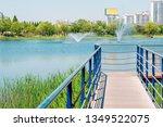 Blue lake and wooden deck walkway in Bucheon Sangdong Lake Park, Korea