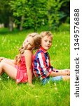 children are sitting on the... | Shutterstock . vector #1349576888