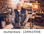 male carpenter working on old... | Shutterstock . vector #1349615558