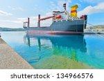greece siros island  cargo ship ... | Shutterstock . vector #134966576